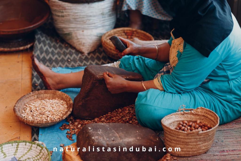 Local woman making argan oil in Morocco