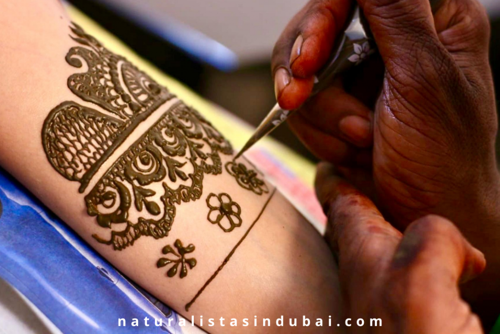 henna being applied to hands